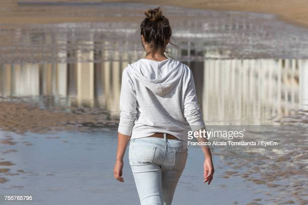 Rear View Of Woman Walking At Beach