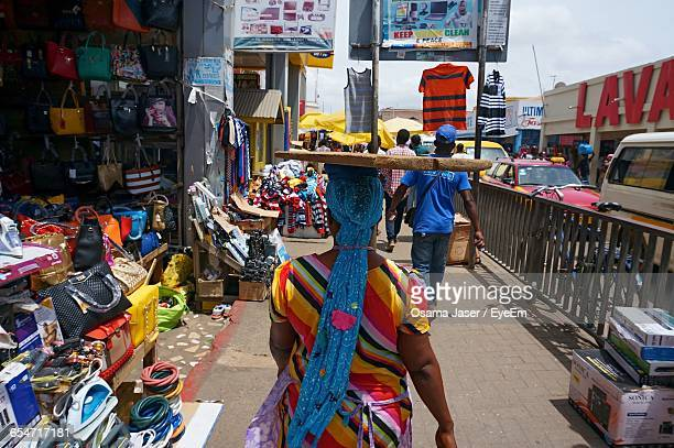 rear view of woman walking at street market - ghana stock pictures, royalty-free photos & images