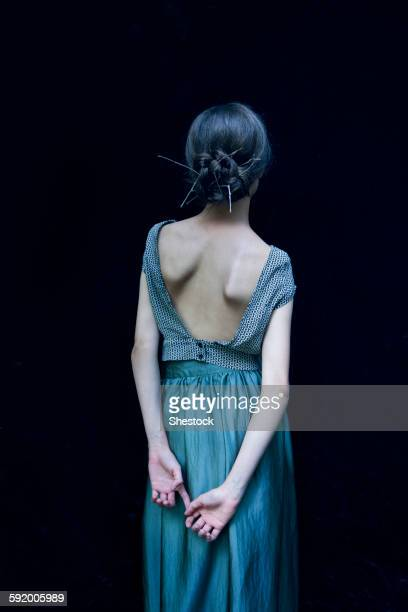 rear view of woman wearing evening gown - evening gown stock pictures, royalty-free photos & images