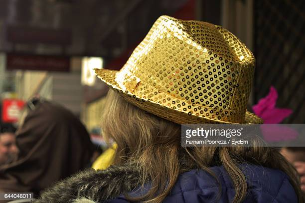 Rear View Of Woman Wearing Fancy Hat