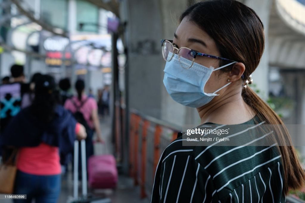 Woman View Stock Rear Of Flu Mask At High-res Wearing Airport