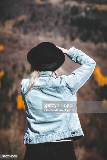 Rear View Of Woman Wearing Hat While Standing Outdoors