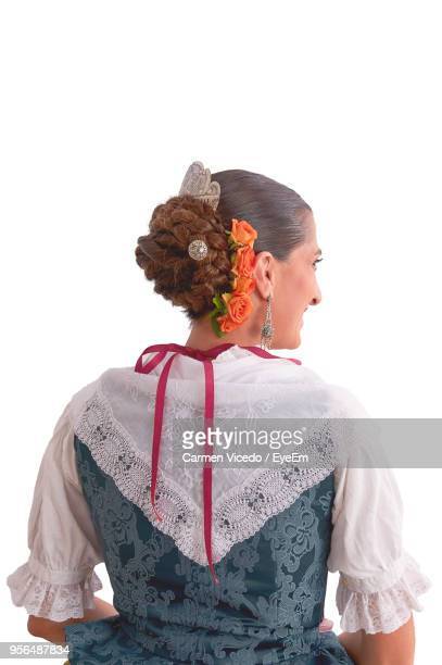 Rear View Of Woman Wearing Traditional Clothing Against White Background