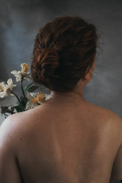Rear View Of Woman While Holding Flowers