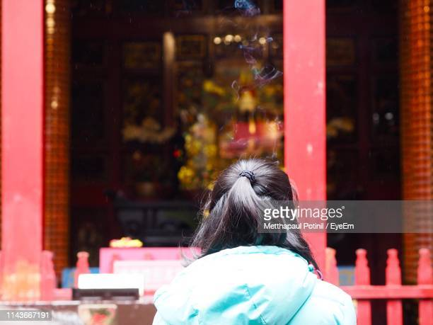 rear view of woman with black hair - metthapaul stock photos and pictures