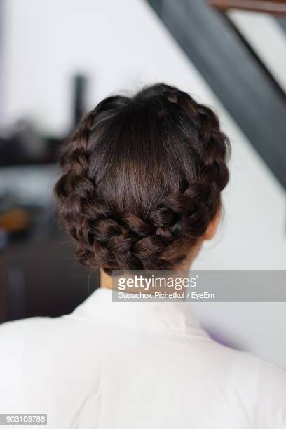 rear view of woman with braided hair - プリーツ ストックフォトと画像