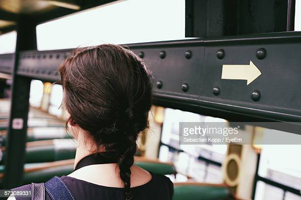 rear view of woman with braided hair sitting in bus - wrong way stock pictures, royalty-free photos & images