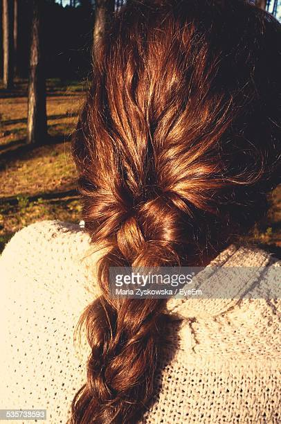Rear View Of Woman With Braided On Sunny Day