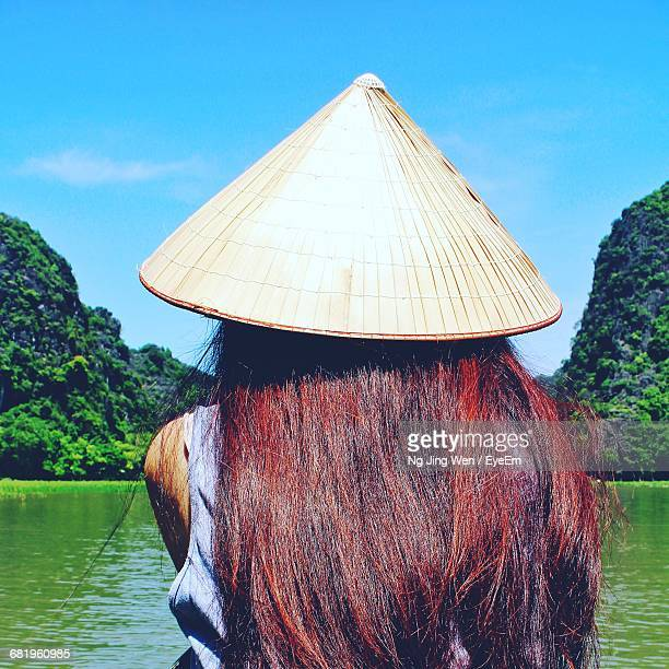 Rear View Of Woman With Conical Hat At Lake