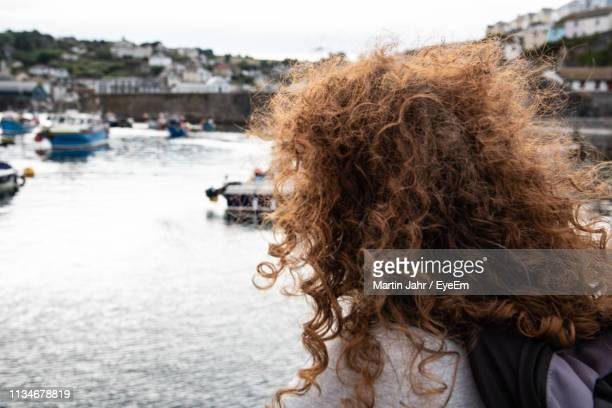 rear view of woman with curly hair - frizzy stock pictures, royalty-free photos & images