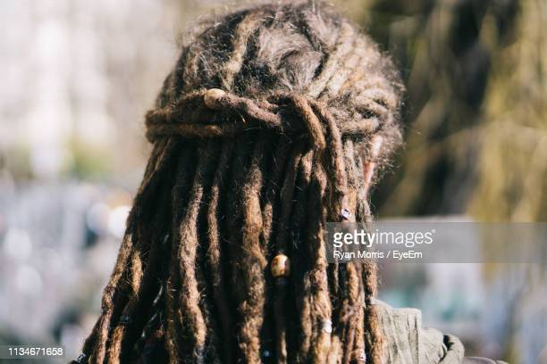 rear view of woman with dreadlocks - dreadlocks stock pictures, royalty-free photos & images
