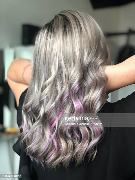 rear view of woman with dyed hair - caprice stock pictures, royalty-free photos & images