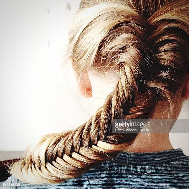 rear view of woman with fishtail braid - braided hair stock pictures, royalty-free photos & images