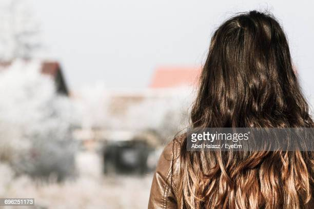 Rear View Of Woman With Hair Against Sky