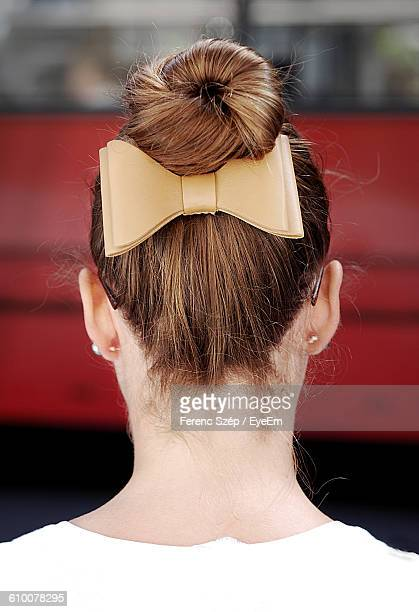rear view of woman with hair bun and bow - up do stock pictures, royalty-free photos & images