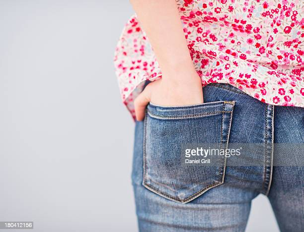 Rear view of woman with hands in pocket