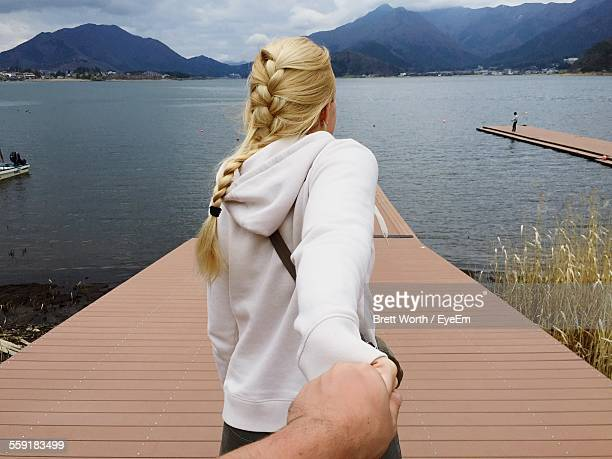 Rear View Of Woman With Her Husband On Pier