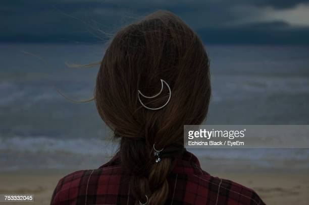 rear view of woman with moon shape hair clip on hair at beach - hair clip stock pictures, royalty-free photos & images