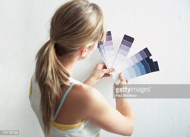 Rear view of woman with paint samples