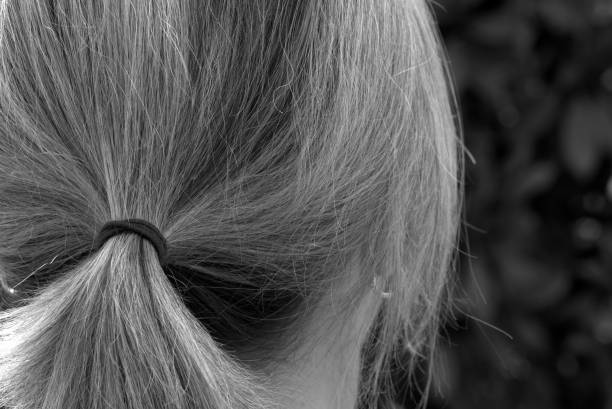 Rear View Of Woman With Ponytail