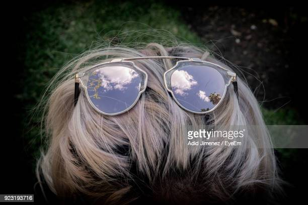 Rear View Of Woman With Sunglasses In Hair