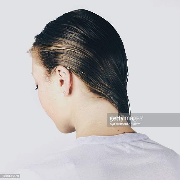 rear view of woman with wet hair against white background - wet hair stock pictures, royalty-free photos & images