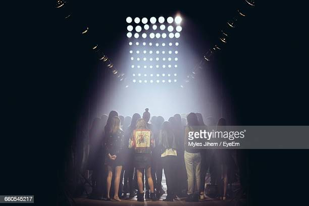 rear view of women at backstage during fashion show - sfilata di moda foto e immagini stock
