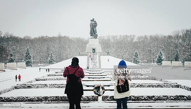 Rear View Of Women At Treptower Park During Winter