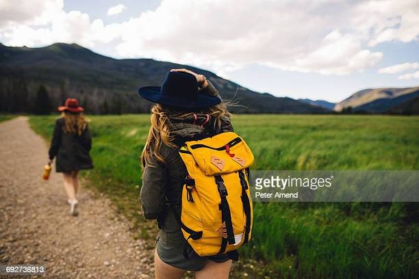 Rear view of women hiking on dirt track, Rocky Mountain National Park, Colorado, USA
