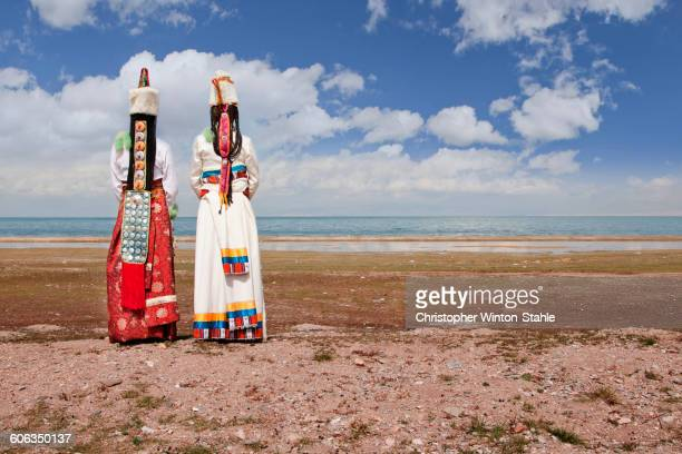 Rear view of women in traditional clothing in remote landscape