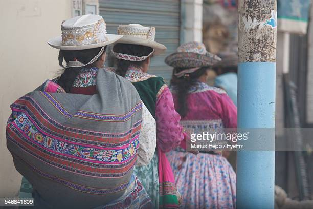 Rear View Of Women In Traditional Wear Outdoors