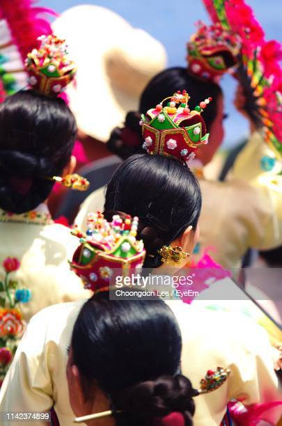 rear view of women wearing traditional clothing during celebration - traditional clothing stock pictures, royalty-free photos & images