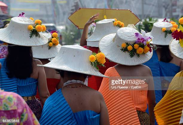 Rear View Of Women Wearing Traditional Dress In City During Songkran