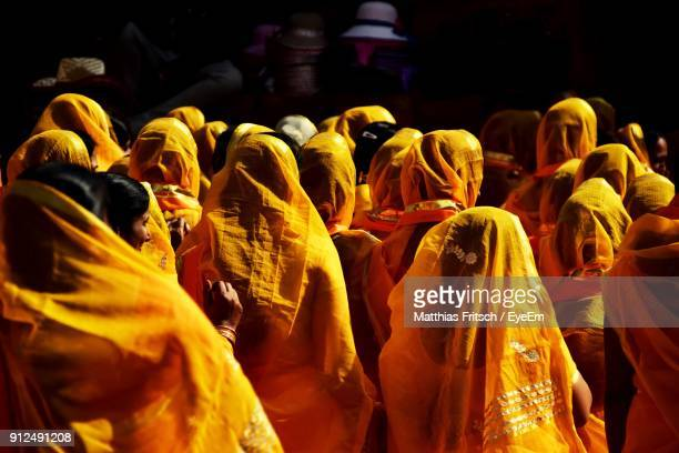 Rear View Of Women Wearing Yellow Sari