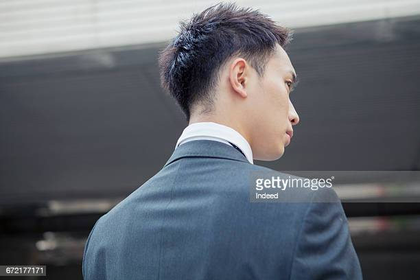 rear view of young businessman - 決意 ストックフォトと画像