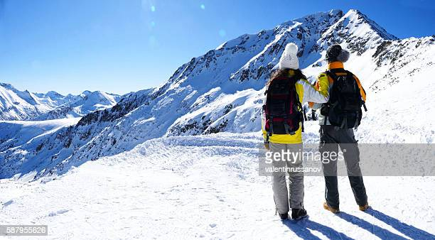 Rear view of young couple enjoying mountain view