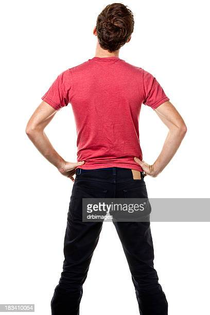 rear view of young man with hands on hips - arms akimbo stock pictures, royalty-free photos & images