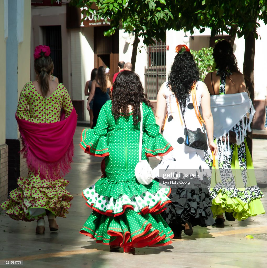 Rear view of young Spanish women dressed in traditional flamenco outfits : Stock Photo