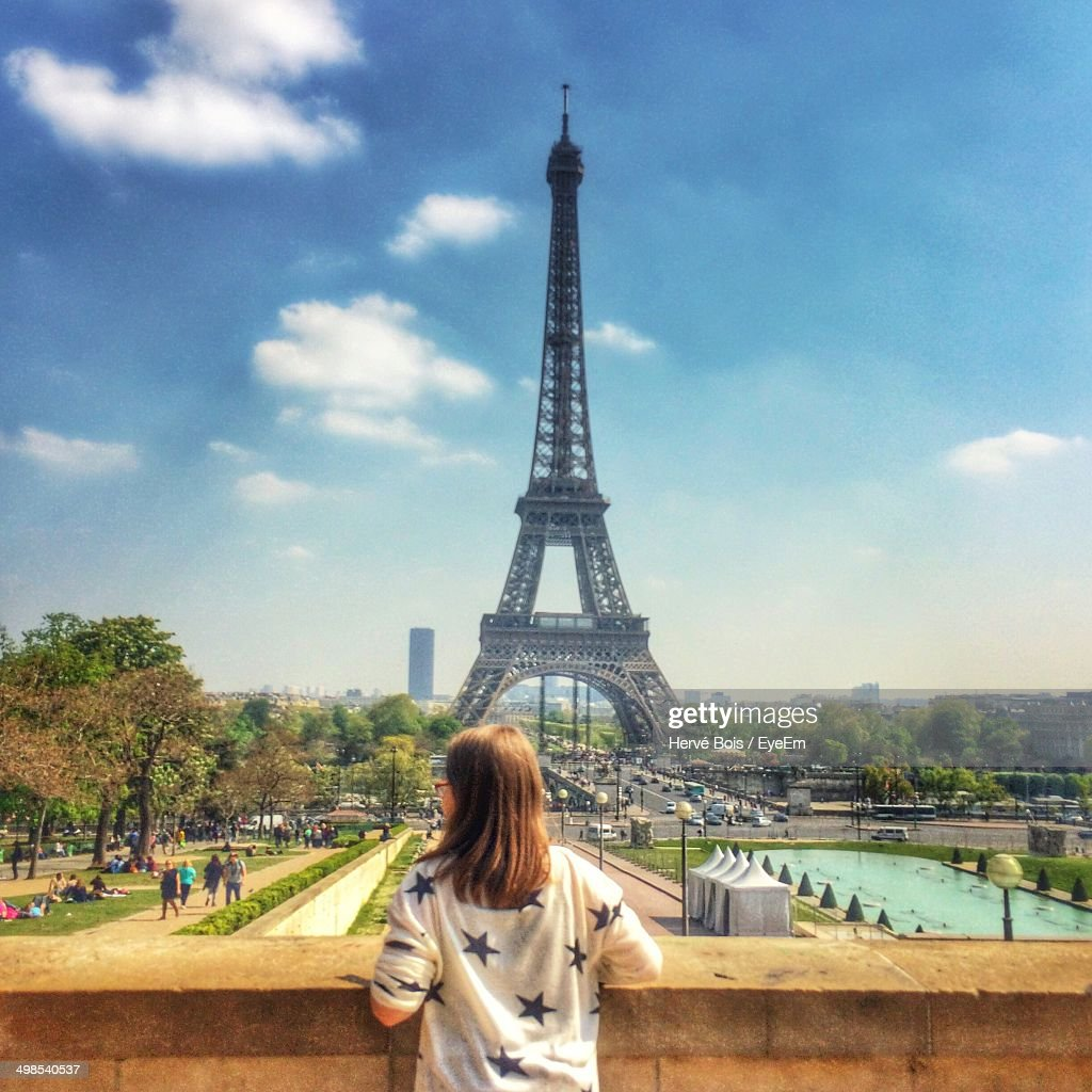 Rear view of young woman against Eiffel Tower : Stock Photo