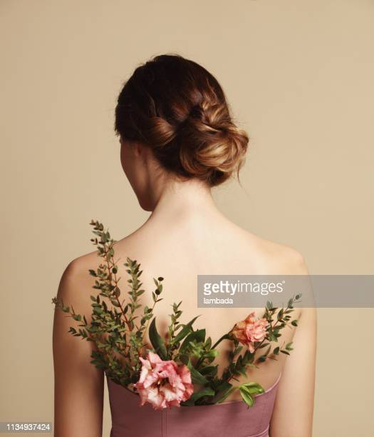 rear view of young woman and flowers - up do stock pictures, royalty-free photos & images