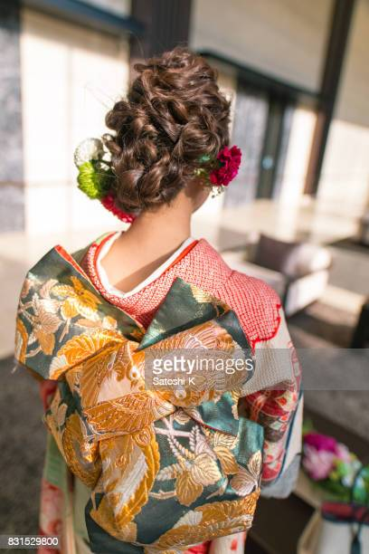 rear view of young woman in furisode kimono for coming of age ceremony - seijin no hi stock pictures, royalty-free photos & images