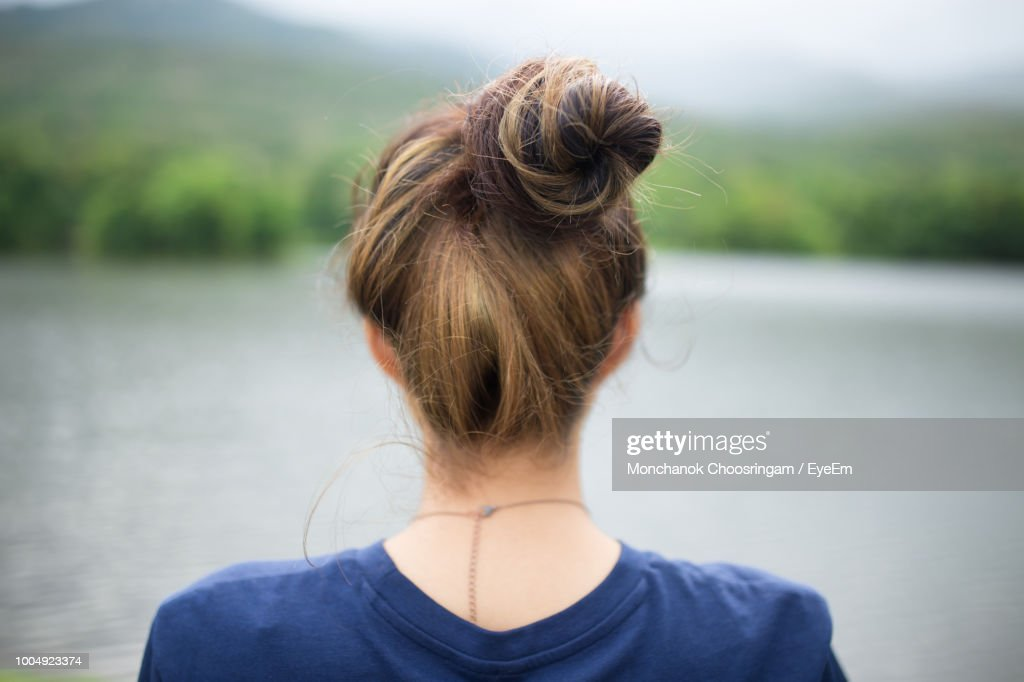 Rear View Of Young Woman Looking At Lake : Stock Photo