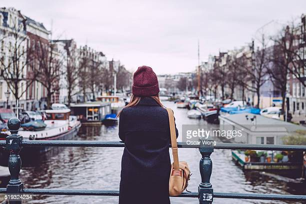 Rear view of young woman looking at view on bridge