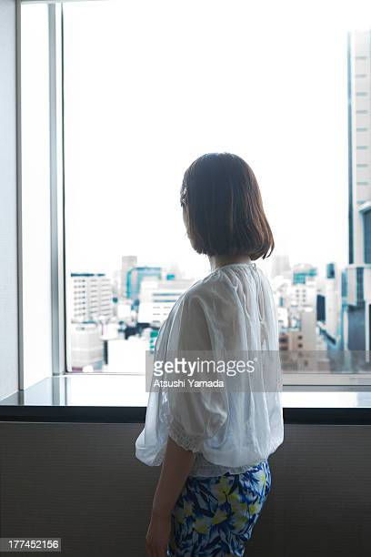 Rear view of young woman looking cityscape