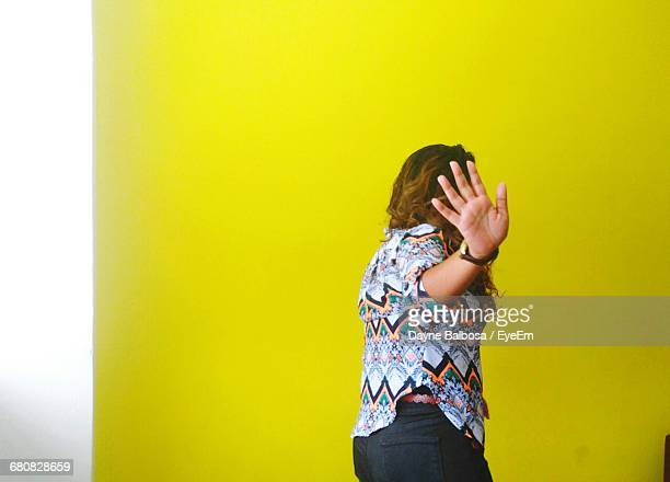 rear view of young woman making stop gesture - refusing stock pictures, royalty-free photos & images
