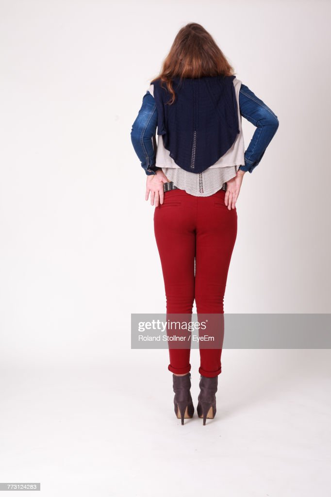 Rear View Of Young Woman Standing Against White Background : Photo
