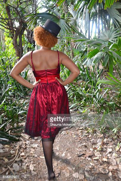 Rear View Of Young Woman Walking In Park