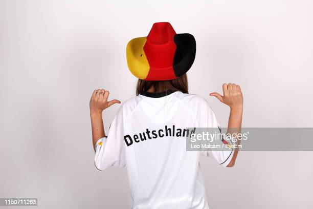 rear view of young woman wearing sports jersey against white background - scrittura non occidentale foto e immagini stock