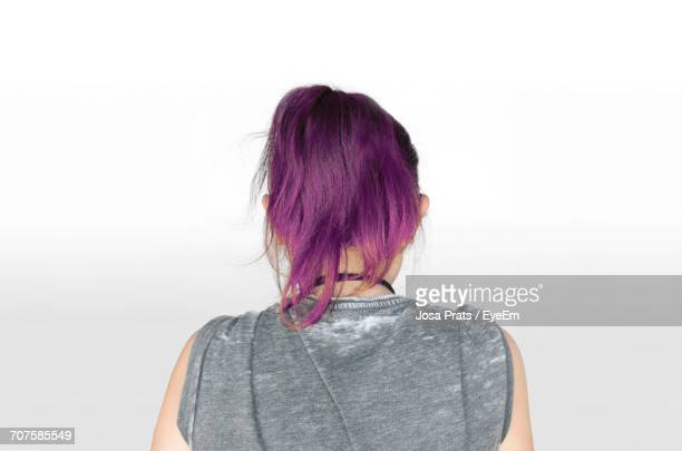 Rear View Of Young Woman With Dyed Hair Against White Background