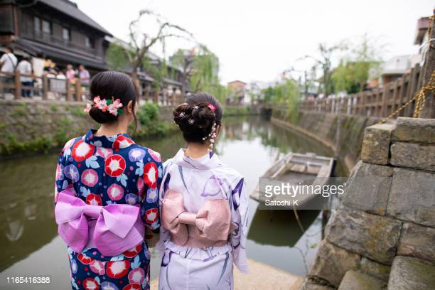 rear view of young women in yukata looking at view from river side - chiba prefecture stock pictures, royalty-free photos & images